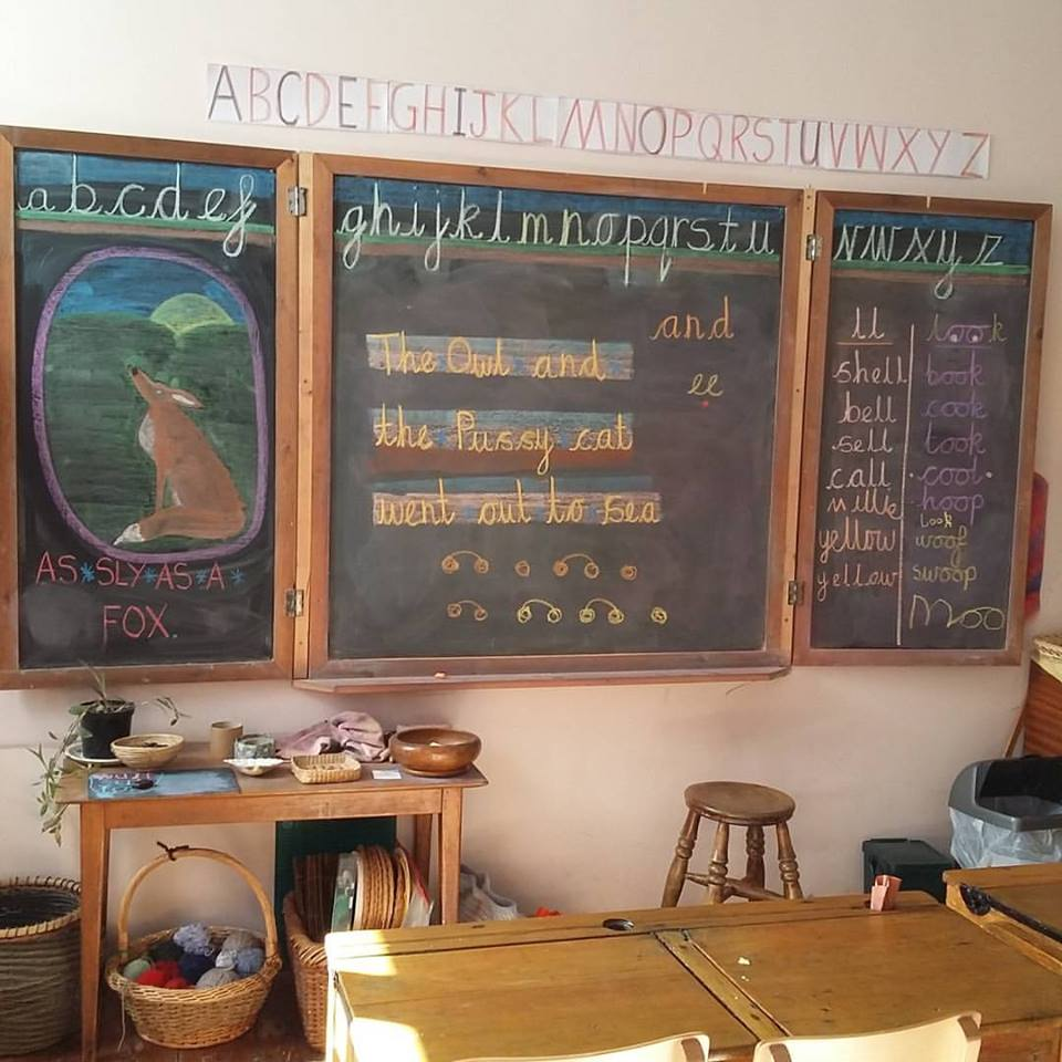 a typical blackboard display showing the alphabet and beautiful chalk drawing of a fox.