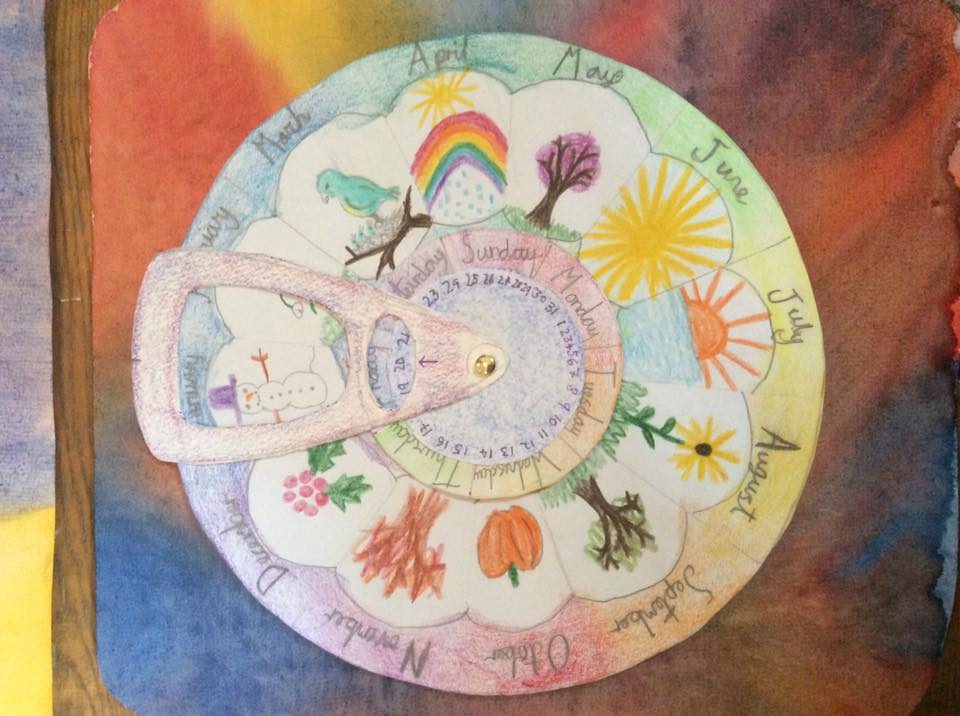 A colourful circular calendar made by a pupil with a picture for each month of the year